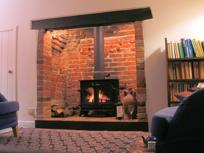S Cottage chimney, hearth and woodburner